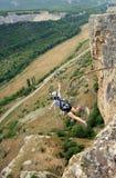 Salte de un acantilado con una cuerda Fotografía de archivo libre de regalías