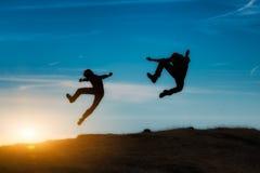 Salte en la puesta del sol Imagen de archivo libre de regalías