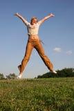 Salte a la muchacha Fotografía de archivo libre de regalías