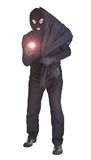 Salteador com lanterna elétrica e saco Fotografia de Stock
