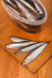 Salted anchovies in box on wooden Stock Photo