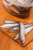 Salted anchovies in box on wooden Royalty Free Stock Photo