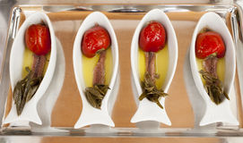 Salted anchovy fillets with Mediterranean spices and herbs. Salted anchovy fillets tasty served with Mediterranean spices and herbs Stock Image
