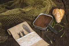 Salted anchovy fillets in olive oil tin can stock images