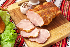Salted boiled pork on the cutting board. Stock Photos
