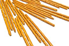 Salted breadsticks on white. Many salted breadsticks on white background closeup Stock Images