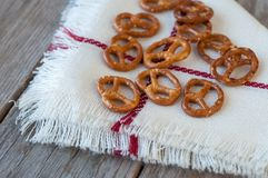 Salted bretzels on a linen napkin. Selective focus. Crisp Royalty Free Stock Photography