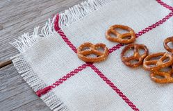 Salted bretzels on a linen napkin. Selective focus. Royalty Free Stock Photo