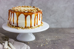 Salted caramel  and nuts cake Royalty Free Stock Image
