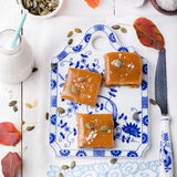 Salted caramel with pumpkin puree and seeds Stock Photos