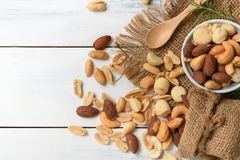 Salted cocktail nuts on white wood royalty free stock images