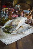 Salted cod cut on the table of the kitchen Stock Photos