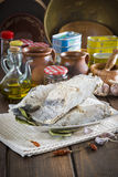 Salted cod cut on the table of the kitchen Stock Images