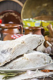 Salted cod cut on the table of the kitchen Royalty Free Stock Photos