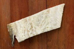 Salted cod fish on brown Royalty Free Stock Photography
