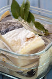 Salted cod fish in water in glass dish Royalty Free Stock Photo