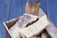 Salted cod fish in wooden box Stock Photography