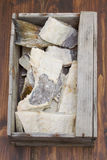 Salted cod fish in wooden box Royalty Free Stock Photos