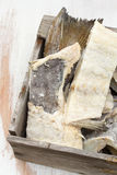 Salted cod fish in wooden box Stock Image