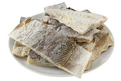 Salted codfish. On the plate Stock Photos