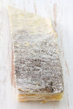 Salted codfish on old board Stock Photo