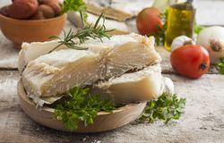 Salted codfish. On the wooden table with ingredients Royalty Free Stock Photos