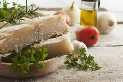 Salted codfish. On the wooden table with ingredients Royalty Free Stock Photography
