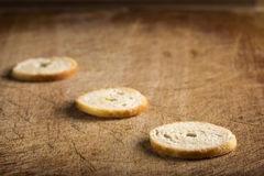 Salted crackers cookies. Close up of some crackers cookies over wooden background Stock Images