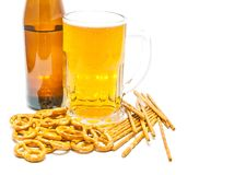 Salted crackers and light beer. Light beer and crackers closeup on white background Stock Images