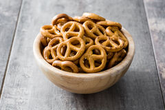 Salted crunchy pretzels in bowl Stock Images