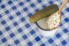 Salted cucumber, milk and pills Royalty Free Stock Photos