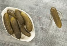 Salted cucumbers and vodka Stock Images