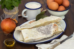Salted dry codfish with eggs Stock Photos