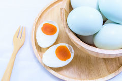 Salted duck egg. In wooden cup on white background royalty free stock image