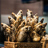 Salted fish. A basket of salted fish at the farmers market Stock Photo