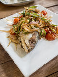 Salted fish fried topped with red onion, chili, tomato Stock Photography