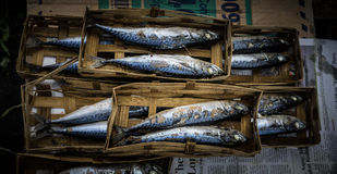 Salted fish packed with bamboo webbing on sale in Bogor traditiona market Stock Photo