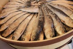 Salted fish products for sale at a market stall stock photography