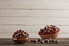 Salted Hazelnuts on Wooden Table. Salted Hazelnuts on Rustic Wooden Table Royalty Free Stock Image