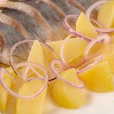 Salted herring with boiled potatoes Royalty Free Stock Images