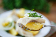 Salted herring with boiled potatoes Stock Photography