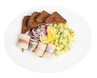 Salted herring fillet with pickles and potatoes. Royalty Free Stock Photography