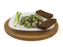 Salted herring marinated with dill onion and bread. Salted herring marinated with dill, onion and bread on a board royalty free stock image