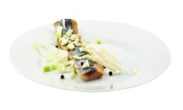Salted herring on the plate Stock Images