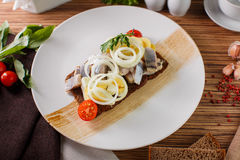 Salted herring and potato. Russian menu Herring with potatoes and eggs on a white plate Stock Photos