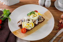 Salted herring and potato. Russian menu Herring with potatoes and eggs on a white plate Stock Photo