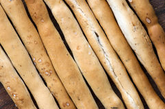 Salted Italian grissini on wooden cutting board close up Royalty Free Stock Images