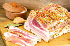 Salted Lard, Raw Pork with Spices on Wooden Royalty Free Stock Photo