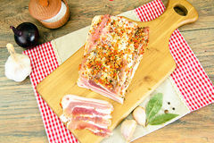 Salted Lard, Raw Pork with Spices on Wooden Royalty Free Stock Images