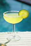 Salted Margarita Poolside. Salted Margarita by the Pool Stock Photo